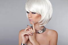 Fashion Beauty Girl. Blond Woman Portrait. Stylish Haircut and M stock photography