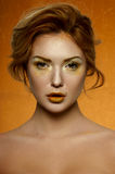 Fashion beauty Girl with gold Makeup Stock Photo