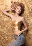 Fashion Beauty Girl Lying On Golden Glitter. Royalty Free Stock Photo