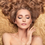 Fashion Beauty Girl Lying On Golden Glitter. Royalty Free Stock Photos