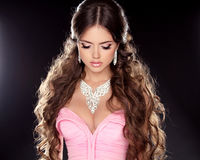 Fashion Beauty Girl with Necklace isolated on black background. Royalty Free Stock Image