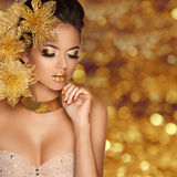 Fashion Beauty Girl portrait with flowers Isolated on golden Royalty Free Stock Photos