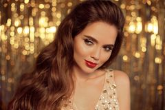 Fashion Beauty Girl Portrait on golden Christmas glitte royalty free stock image