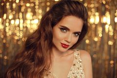 Fashion Beauty Girl Portrait on golden Christmas glitte royalty free stock photo