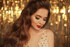 Fashion Beauty Girl Portrait on golden Christmas glitte royalty free stock photos