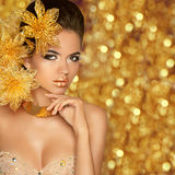 Fashion Beauty Girl Portrait Isolated on golden Christmas glitte Stock Images