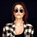 Fashion beauty girl wearing sunglasses, plaid shirt. Image toned Stock Photo