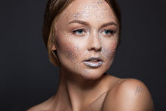 Fashion beauty glamor girl. Face in Glitter Powder. Close-up portrait of a woman Royalty Free Stock Photography