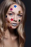 Fashion beauty glamor girl. Multi-colored metallic stars in her hair. Royalty Free Stock Photography
