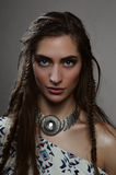 Fashion beauty horsewoman model with brunette braids and pendant Royalty Free Stock Photos