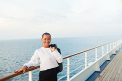 Fashion, beauty, look. Happy woman with business jacket on shipboard in miami, usa. Travelling for business. Sensual woman smile o. N ship board on blue sea Stock Photography