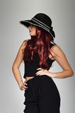 Fashion and beauty model in a chic black ensemble Stock Photo