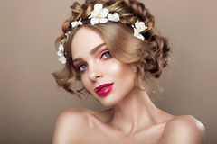 Fashion Beauty Model Girl with Flowers Hair. Bride. Perfect Creative Make up and Hair Style. Hairstyle. Beautiful Flowers Royalty Free Stock Image