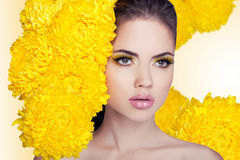 Fashion Beauty Model Girl with Flowers Hair. Makeup and Hair St stock photo