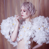 Fashion Beauty Model Girl in white Roses.  Bride. Perfect Creative Make up and Hairstyle. Stock Image