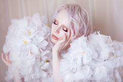 Fashion Beauty Model Girl in white Roses.  Bride. Perfect Creative Make up and Hairstyle. Stock Images