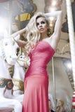 Fashion beauty model posing on carousel Royalty Free Stock Image
