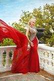 Fashion beauty outdoor portrait of beautiful woman in red dress Royalty Free Stock Images