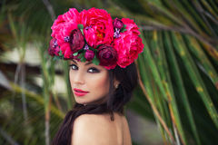 Fashion beauty portrait of beautiful brunette girl with wreath of flowers on her head Stock Images