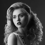 Fashion beauty portrait of blonde girl with updo royalty free stock images