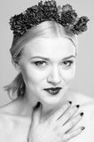 Fashion beauty portrait with a headpiece of flowers Royalty Free Stock Photo