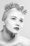 Fashion beauty portrait with a headpiece of flowers Stock Images