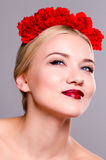 Fashion beauty portrait with a headpiece of flowers Royalty Free Stock Images