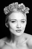 Fashion beauty portrait with a headpiece of flowers Stock Photo