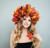 Fashion beauty portrait of pretty woman in autumn leaves crown.  royalty free stock photography