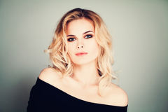 Fashion Beauty Portrait of Pretty Woman Model witn Blonde Hair. And Makeup Stock Photo