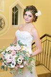 Bride is holding a big bouquet of flowers stock photos