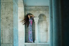Fashion and beauty salon. girl in indian style dress in castle. girl in long dress with brunette hair. Fashion. Model or princess has romantic mood. Woman at stock photo