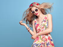Fashion Beauty. Sensual Blond Model. Summer Outfit. Fashion Beauty. Sensual Sexy Blond Model in fashion pose Smiling. Woman in Summer Outfit. Trendy Floral Dress Royalty Free Stock Image