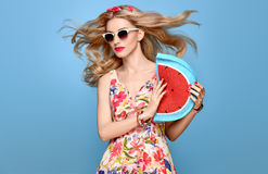 Fashion Beauty. Sensual Blond Model. Summer Outfit. Fashion Beauty woman in Summer Outfit. Sensual Sexy Blond Model in fashion pose Smiling. Trendy Floral summer Royalty Free Stock Photo
