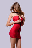 Fashion beauty unzipping red dress Royalty Free Stock Image