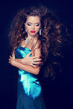 Fashion Beauty Vogue Model Girl in elegant blue dress with blowi royalty free stock photography
