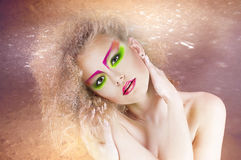 Fashion beauty woman with colorful makeup and creative hairstyle royalty free stock photography