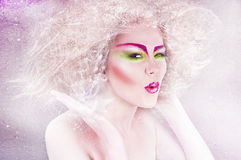 Fashion beauty woman with colorful makeup and creative hairstyle Stock Photos