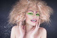 Fashion beauty woman with colorful makeup and creative hairstyle Stock Photo