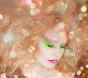 Fashion beauty woman with colorful makeup and creative hairstyle. Covering fairy background. Magic card royalty free stock images