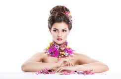 Fashion Beauty woman with flowers in her hair and around her neck. Perfect Creative Make up and Hair Style. Hairstyle. Bouquet of Beautiful Flowers. It can be royalty free stock photography