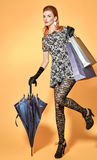 Fashion beauty woman holding shopping bags.Vintage Stock Image