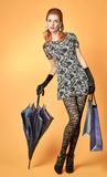 Fashion beauty woman holding shopping bags.Vintage Stock Photography