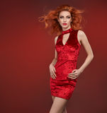Fashion Beauty woman in Red Dress. Party Outfit. Fashion Beauty woman in Glamour Red Dress. Stylish Luxury Party Girl, Makeup. Redhead Model, Fashion wavy royalty free stock photography