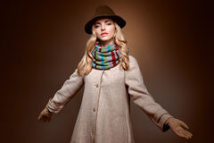 Fashion beauty woman in stylish coat hat, autumn. Fashion beauty woman in stylish long coat, hat. Autumn winter model blonde girl with long blonde wavy hair in Royalty Free Stock Photography