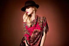 Fashion beauty woman in stylish hat shawl, autumn. Fashion beauty woman in stylish hat, colored cashmere shawl. Autumn winter model blond girl with long blonde Royalty Free Stock Photography
