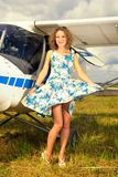 Fashion beautyful woman in pinup style dress nearby ultralight plane Royalty Free Stock Photo