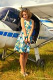 Fashion beautyful woman in pinup style dress nearby ultralight plane Royalty Free Stock Photography