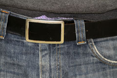Fashion belt buckle on denim jeans Royalty Free Stock Images