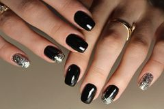 fashion black and gold color manicure design royalty free stock photos